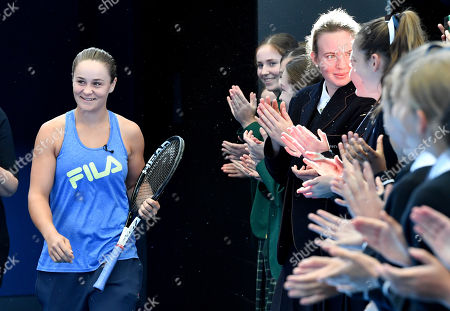 French Open winner and world number one tennis player Ashleigh Barty (C) is welcomed home during an event at Pat Rafter Arena in Brisbane, Australia, 25 July 2019. Queensland Premier Annastacia Palaszczuk and 70 junior tennis players officially welcomed home Ashleigh Barty to Australia after her recent French Open win.