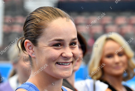 French Open winner and world number one tennis player Ashleigh Barty (C) smiled during a welcome home event at Pat Rafter Arena in Brisbane, Australia, 25 July 2019. Queensland Premier Annastacia Palaszczuk and 70 junior tennis players officially welcomed home Ashleigh Barty to Australia after her recent French Open win.