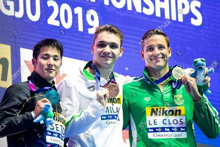 Kristof Milak of Hungary (C), Daiya Seto of Japan (L), Chad le Clos of South Africa (R) during the Victory Ceremony for Men's 200m butterfly