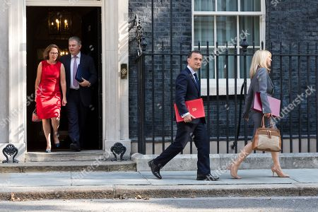 Britain's Leader of the House of Lords Natalie Evans (L) and newly appointed Britain's Minister Of State For The Home Department Brandon Lewis (2L), Britain's Welsh secretary, Alun Cairns (C), British Housing, Communities and Local Government Minister Esther McVey (R) leave after a cabinet meeting at Downing Street, central London