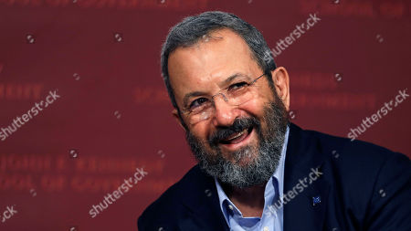 """Former Israeli Prime Minister Ehud Barak smiles during a lecture at the John F. Kennedy School of Government at Harvard University in Cambridge, Mass. In a joint statement Thursday, """"The Democratic Camp"""" says it would be made up of former Prime Minister Ehud Barak's """"Democratic Israel"""" faction, the dovish Meretz party and senior Labor Party official Stav Shaffir. Together, the group aims to pose a powerful contrast to Prime Minister Benjamin Netanyahu's conservative ruling Likud party"""