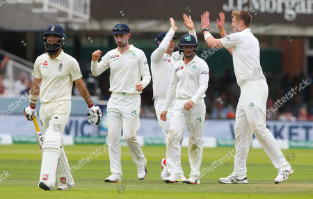 England's Moeen Ali leaves the field out for 9 runs  bowled Boyd Rankin of Ireland (celebrating R ) caught Wilson