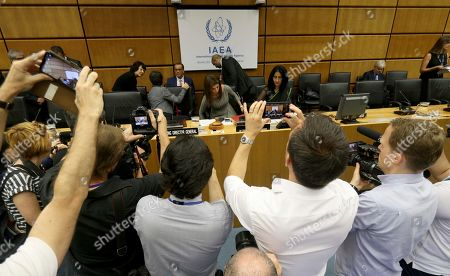 Journalists take pictures of the board of governors meeting for a tribute to the late Director General of the International Atomic Energy Agency, IAEA, Yukiya Amano of Japan at the International Center in Vienna, Austria, . The IAEA announced the death of the agency's Director General Yukiya Amano at the age of 72 years