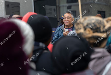 Zackie Achmat (C) South African activist and founder the Treatment Action Campaign speaks with South Africans protesting outside the German consulate general in Cape Town, South Africa, 25 July 2019. A group of South Africans led by the Unite Behind civil society organisation protested outside the German consulate calling on the German government to prosecute the German companies implicated in South Africa's state capture and sanction companies implicated in the corruption scandal at the Passenger Rail Agency of South Africa (PRASA). The German government owned rail company Deutsche Bahn has been implicated in the PRASA tender scandal. Former South African president Jacob Zuma is currently on trial for allegations of fraud also involving German companies.