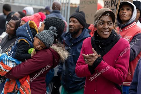 South Africans protest outside the German consulate general in Cape Town, South Africa, 25 July 2019. A group of South Africans led by the Unite Behind civil society organisation protested outside the German consulate calling on the German government to prosecute the German companies implicated in South Africa's state capture and sanction companies implicated in the corruption scandal at the Passenger Rail Agency of South Africa (PRASA). The German government owned rail company Deutsche Bahn has been implicated in the PRASA tender scandal. Former South African president Jacob Zuma is currently on trial for allegations of fraud also involving German companies.