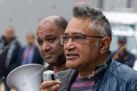 Zackie Achmat South African activist and founder the Treatment Action Campaign speaks with South Africans protesting outside the German consulate general in Cape Town, South Africa, 25 July 2019. A group of South Africans led by the Unite Behind civil society organisation protested outside the German consulate calling on the German government to prosecute the German companies implicated in South Africa's state capture and sanction companies implicated in the corruption scandal at the Passenger Rail Agency of South Africa (PRASA). The German government owned rail company Deutsche Bahn has been implicated in the PRASA tender scandal. Former South African president Jacob Zuma is currently on trial for allegations of fraud also involving German companies.