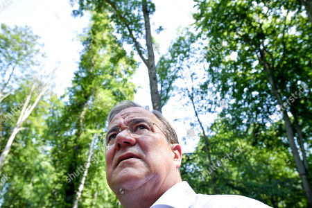 The Prime Minister of North Rhine-Westphalia Armin Laschet informs himself about the current situation and perspectives of North Rhine-Westphalian forests during an inspection at the 'Koenigsforst' in Bergisch Gladbach, Germany, 25 July 2019. More than 25 percent of the state area of North Rhine-Westphalia is forested. In recent years, storms, prolonged drought and, as a result, the spread of the bark beetle have caused lasting damage to the tree population and forest biotopes.