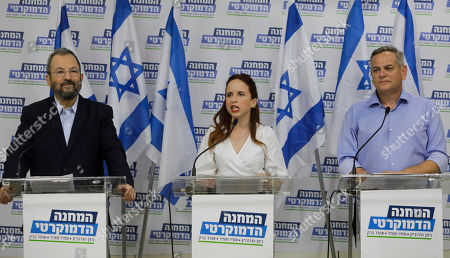 """Ehud Barak, left, Tamar Zandberg, and Stav Shaffir. announce their joint faction """"The Democratic Camp"""" for the upcoming elections in Israel, in Tel Aviv"""