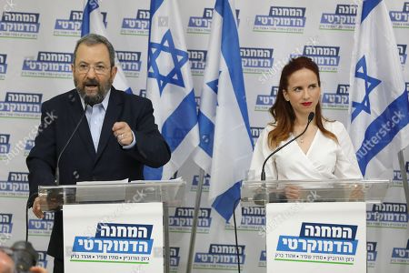 Stock Photo of Former Israeli Prime Minister Ehud Barak (L) during a press conference with Labor Party member Stav Shafir (R) and chairman of Meretz party Nitzan Horowitz (unseen) in Tel Aviv, Israel, 25 July 2019. The three leaders announced on a joint political union under the 'Democratic Camp' left -wing party for  the upcoming 17 September 2019 Israeli legislative election. aiming to challenge Prime Minister Netanyahu conservative Party Likud.