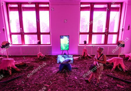 A visitor looks at the installation 'Mesocosmic Indoor Overture' by British artist Heather Phillipson as part of the exhibition 'Garden of Earthly Delights' in the Martin Gropius Bau in Berlin, Germany, 25 July 2019. Over 20 international artists used the space of the garden as a metaphor for the state of the world. The exhibition runs from 26 July to 01 December 2019.