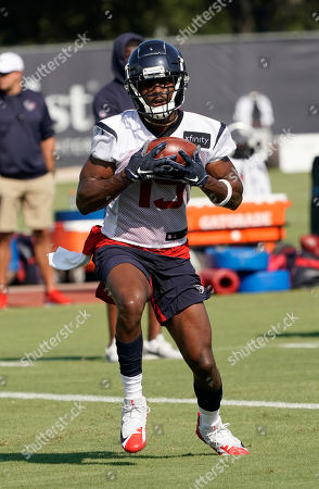 Houston Texans wide receiver Isaac Whitney (19) catches a pass during an NFL football training camp practice, in Houston