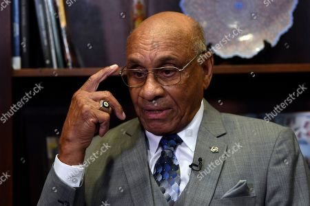 Willie O'Ree, the first black player to compete in the NHL, talks during a meeting with Sen. Tim Scott, R-S.C., on Capitol Hill in Washington, . Scott and Sen. Debbie Stabenow, D-Mich., announced their bipartisan legislation to award the Congressional Gold Medal to O'Ree