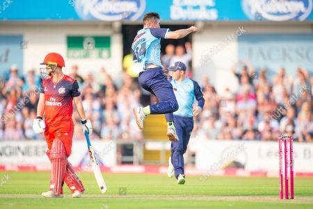 Yorkshire's Jordan Thompson celebrates dismissing Lancashire's Alex Davies.