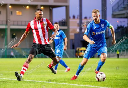 Bogdan Ilie Vatajelu (R) of Craiova in action against David N'Gog (L) of Honved during the UEFA Europa League second qualifying round, first leg soccer match between Budapest Honved and Universitatea Craiova in Gyor, Hungary, 25 July 2019.