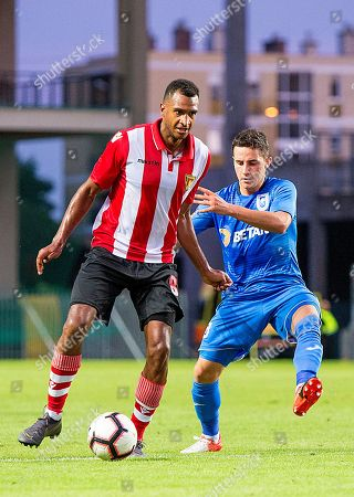 Stock Image of Antoni Valeri Ivanov (R) of Craiova in action against David N'Gog (L) of Honved during the UEFA Europa League second qualifying round, first leg soccer match between Budapest Honved and Universitatea Craiova in Gyor, Hungary, 25 July 2019.