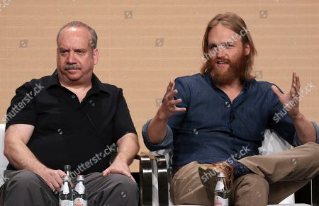 "Paul Giamatti, Wyatt Russell. Executive producer Paul Giamatti, left, and Wyatt Russell participate in AMC's ""Lodge 49"" panel at the Television Critics Association Summer Press Tour, in Beverly Hills, Calif"