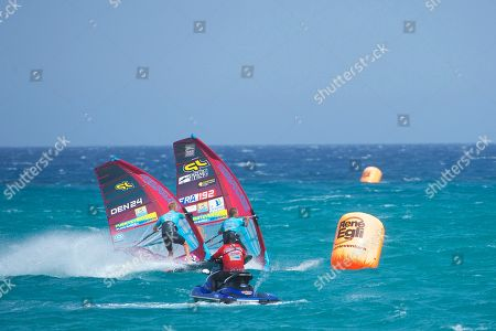 Antoine Albeau (R) of France and Sebastian Kornum (L) of Denmark in action during the slalom trial of the Windsurfing World Cup at Costa Calma, Fuerteventura, Canary Islands, Spain, 25 July 2019.