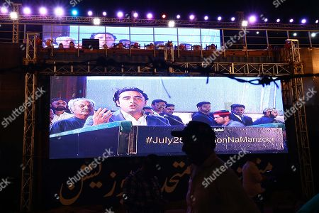 Stock Picture of Bilawal Bhutto Zardari leader of opposition political party Pakistan People Party talks with supporters of opposition political parties as they observe anniversary of the general elections as 'BLACK DAY' to protest government policies, in Karachi, Pakistan, 25 July 2019. The Pakistani general elections were held on 25 July 2018 bringing Imran Khan and his Pakistan Tehreek-e-Insaf party (PTI) into power.
