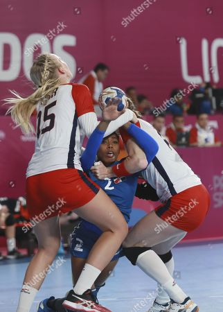 Stock Photo of Yojaver Brito (C) of Dominican Republic is blocked by Nicol Andersen (L) and Jennifer Fithian of USA during an handball game at the Lima 2019 Pan American Games, in Lima, Peru, 25 July 2019. The Lima 2019 Pan American Games will run from 26 July to 11 August.