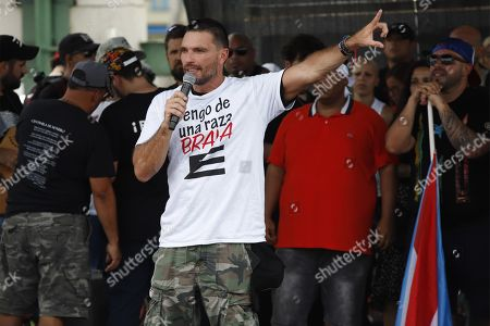 Actor Julian Gil speaks to the crowd during 'We Are More' march, in the Hato Rey neighborhood of the Municipality of San Juan, Puerto Rico, 25 July 2019. Hundreds of Puerto Ricans began a march to celebrate the resignation of the island's Governor Ricardo Rossello, a night earlier, effective 02 August.