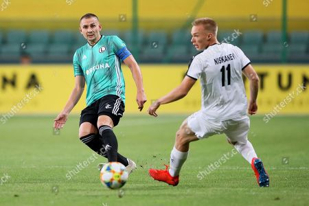 Legia's Artur Jedrzejczyk (L) in action against Ilmari Niskanen (R) of Kuopio during the UEFA Europa League second qualifying round, first leg soccer match between Legia Warsaw and KuPS Kuopio in Warsaw, Poland, 25 July 2019.
