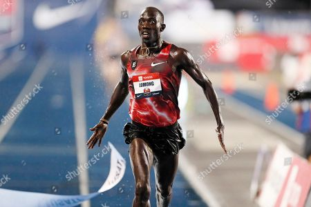 Lopez Lomong reacts as he wins the men's 10,000-meter run at the U.S. Championships athletics meet, in Des Moines, Iowa