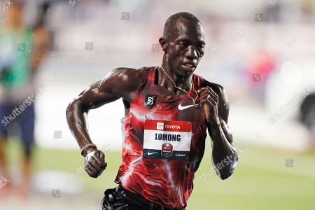 Lopez Lomong leads during the men's 10,000-meter run at the U.S. Championships athletics meet, in Des Moines, Iowa