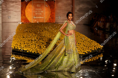 Bollywood actress Malaika Arora displays a creation by Indian designer Sulakshana Monga during the India Couture Week in New Delhi, India