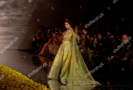 Stock Photo of Bollywood actress Malaika Arora displays a creation by Indian designer Sulakshana Monga during the India Couture Week in New Delhi, India