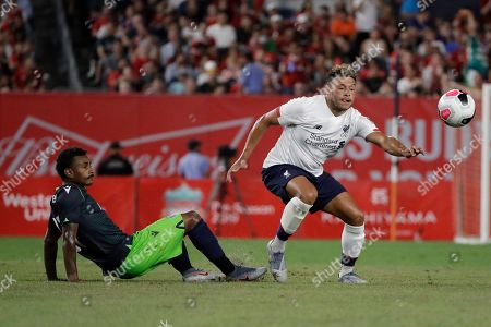 Stock Photo of Sporting CP's Marcus Wendel, left, fights for control of the ball with Liverpool FC's Daniel Sturridge during the second half of a soccer match, in New York. The game ended 2-2