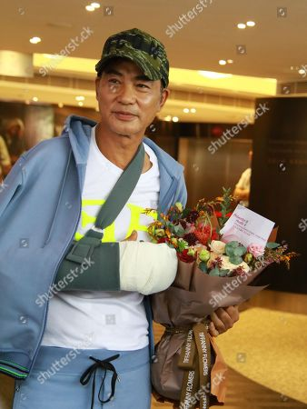 Stock Picture of Simon Yam, who was attacked by a man in Guangdong, left hospital after four days treatment