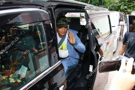 Stock Image of Simon Yam, who was attacked by a man in Guangdong, left hospital after four days treatment