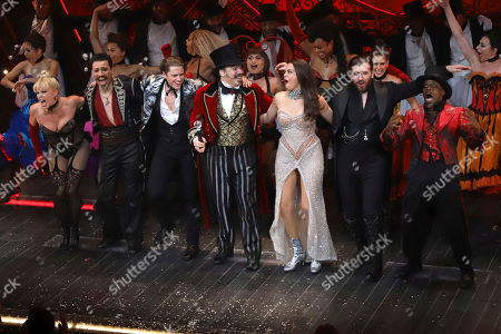 "Robyn Hurder, Ricky Rojas, Aaron Tveit, Danny Burstein, Karen Olivo, Tam Mutu, Sahr Nguajah. Robyn Hurder, from left, Ricky Rojas, Aaron Tveit, Danny Burstein, Karen Olivo, Tam Mutu and Sahr Nguajah appear at the curtain call for the Broadway opening night of ""Moulin Rouge! The Musical,"" at the Al Hirschfeld Theatre, in New York"