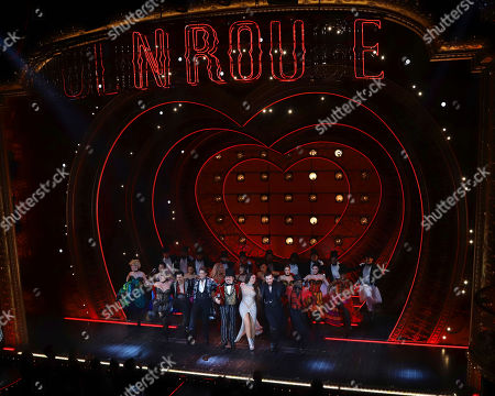 "Stock Picture of Robyn Hurder, Ricky Rojas, Aaron Tveit, Danny Burstein, Karen Olivo, Tam Mutu, Sahr Nguajah. Robyn Hurder, from front row left, Ricky Rojas, Aaron Tveit, Danny Burstein, Karen Olivo, Tam Mutu and Sahr Nguajah appear at the curtain call for the Broadway opening night of ""Moulin Rouge! The Musical,"" at the Al Hirschfeld Theatre, in New York"