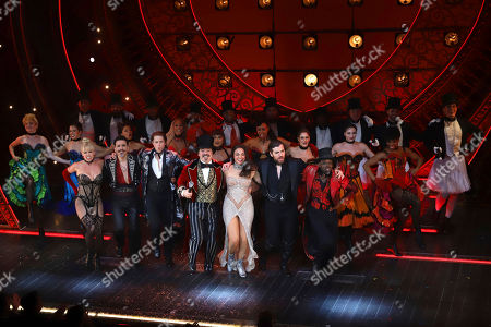 "Stock Photo of Robyn Hurder, Ricky Rojas, Aaron Tveit, Danny Burstein, Karen Olivo, Tam Mutu, Sahr Nguajah. Robyn Hurder, from front row left, Ricky Rojas, Aaron Tveit, Danny Burstein, Karen Olivo, Tam Mutu and Sahr Nguajah appear at the curtain call for the Broadway opening night of ""Moulin Rouge! The Musical,"" at the Al Hirschfeld Theatre, in New York"