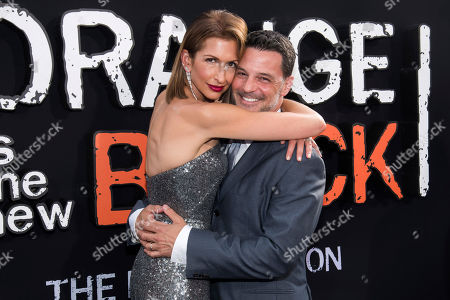 "Alysia Reiner, David Alan Basche. Alysia Reiner and David Alan Basche attend the final season premiere of Netflix's ""Orange Is the New Black"" at Alice Tully Hall, in New York"