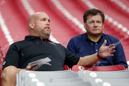Arizona Cardinals' general manager Steve Keim, left, and team president Michael Bidwill watch during the teams' NFL football training camp, in Glendale, Ariz