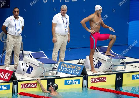 Italy's Luca Dotto reacts after falling into the pool ahead of his heat of the men's 50m freestyle at the World Swimming Championships in Gwangju, South Korea