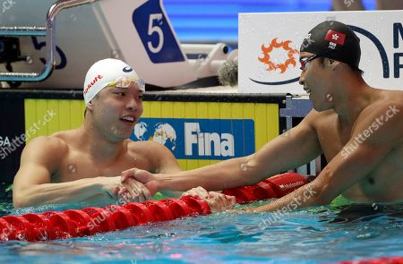 Stock Photo of Taiwan's Wu Chun-Feng, left, shake shands with Hong Kong's Ho Ian Yentou after their men's 50m freestyle at the World Swimming Championships in Gwangju, South Korea