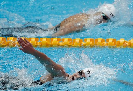 United States' Leah Smith, bottom, swims with compatriot Katie Ledecky in their women's 800m heat at the World Swimming Championships in Gwangju, South Korea