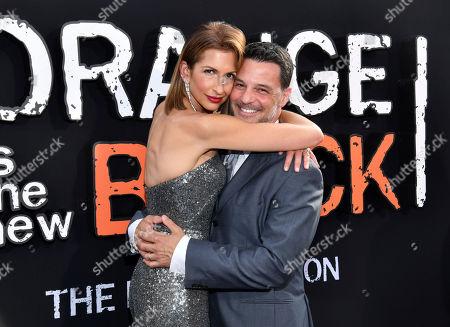 "Alysia Reiner, David Alan Basche. Alysia Reiner and David Alan Basche attend the final season premiere of Netflix's ""Orange Is the New Black"" at Alice Tully Hall, in New York"