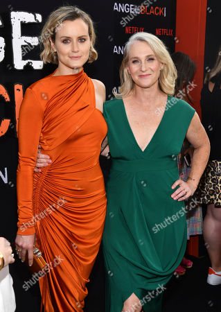 """Taylor Schilling, Piper Kerman. Taylor Schilling, left, and Piper Kerman attend the final season premiere of Netflix's """"Orange Is the New Black"""" at Alice Tully Hall, in New York"""