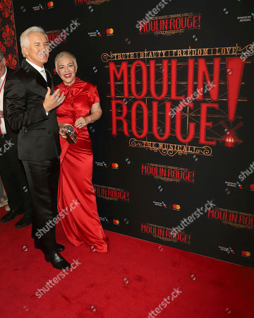 """Stock Picture of Baz Luhrmann, Catherine Martin. Baz Luhrmann, left, and Catherine Martin attend the Broadway opening night of """"Moulin Rouge! The Musical"""" at the Al Hirschfeld Theatre, in New York"""