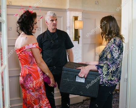 Stock Photo of Ep 9835 Wednesday 31st July 2019 - 1st Ep Robert Preston, as played by Tristan Gemmill, horrified to realise Tyler's awards ceremony is the same function that Michelle and Alya are catering for. In a bid to keep her away from Michelle, Robert advises Vicky, as played by Kerri Quinn, to give the awards a miss and look after her health. But as they serve canapes, Robert's shocked to see Vicky and Tyler across the room. Covering his panic, Robert grabs Vicky and encourages her to go home for the sake of the baby. As he steers her out of the hotel, Robert gives Vicky a protective hug. Tracy McDonald, as played by Kate Ford, spots this and demands to know what's going on. Is the game up?