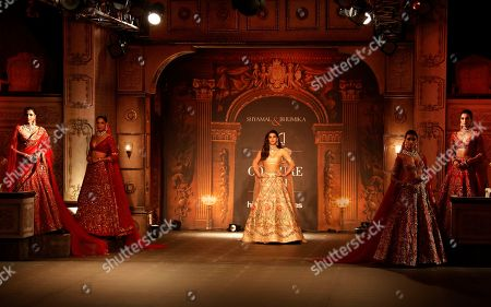 Bollywood actress Kriti Sanon, center, and other models display creations by Indian designers Shyamal & Bhumika during the India Couture Week in New Delhi, India