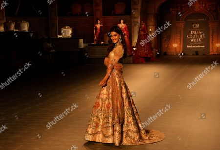 Bollywood actress Kriti Sanon displays a creation by Indian designers Shyamal & Bhumika during the India Couture Week in New Delhi, India
