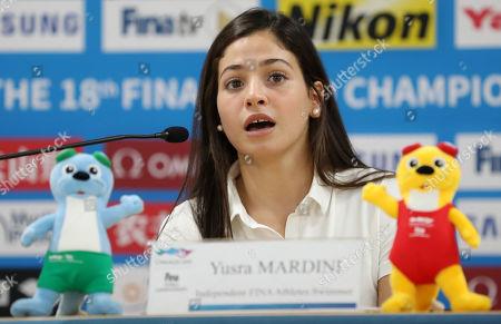 Syrian swimmer Yusra Mardini, who represents a refugee team, speaks during a news conference at the Main Press Center of the FINA World Championships at Nambu University Municipal Aquatics Center in Gwangju, South Korea, 26 July 2019.