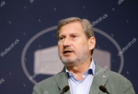 European Commissioner for Enlargement Negotiations Johannes Hahn talks during the joint press conference with Serbian Prime minister Ana Brnabic (not pictured) in Belgrade, Serbia, 26 July 2019. Hahn is on a two day official visit to Serbia.