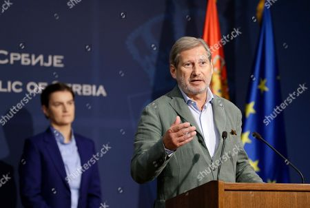 European Commissioner for Enlargement Negotiations Johannes Hahn (R) gestures during the joint press conference with Serbian Prime minister Ana Brnabic in Belgrade, Serbia, 26 July 2019. Hahn is on a two day official visit to Serbia.