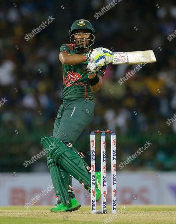 Bangladeshi batsman Sabbir Rahman plays a shot during the first one-day international cricket match between Sri Lanka and Bangladesh in Colombo, Sri Lanka